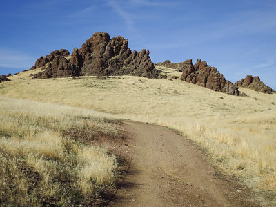 Sky, rock, grass, trail.