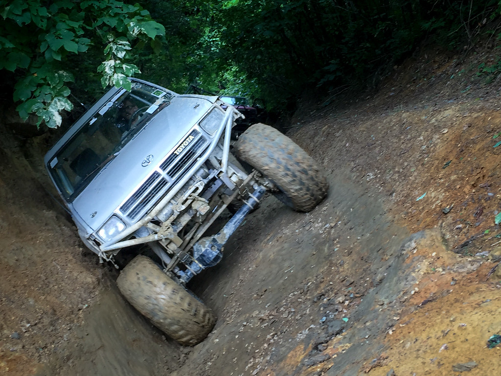 Amazingly deep rut!  The horizon of this shot is correct.  The Toyota is almost on the wall.