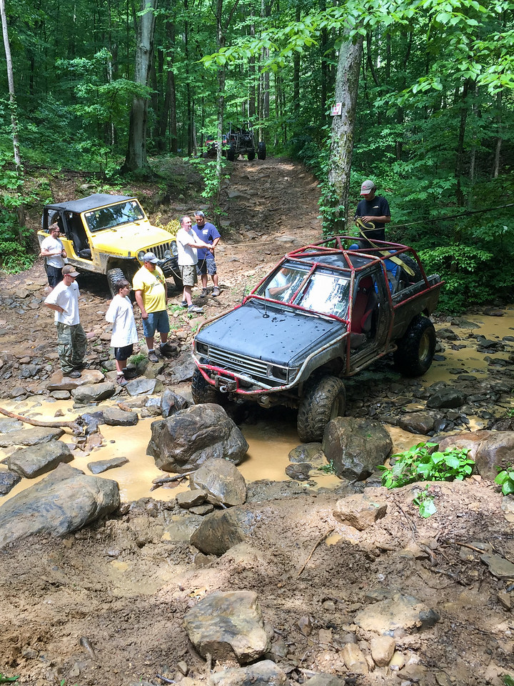 Everyone wanted to watch Ralph replace his drive shaft while laying in the creek.