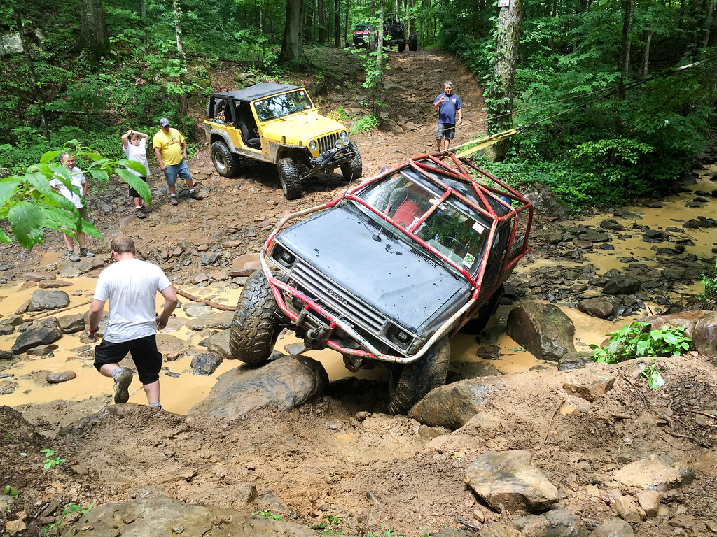 Used the winch to tip  the jeep so that it could be backed out of it's high center breakdown.