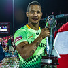 Ryno Benjamin of South Africa displays the cup after South Africa beat Australia 33-7 in the Cup Final of the IRB Sevens World Series rugby tournament at the Emirates Airline Dubai Rugby Sevens in Dubai, UAE, on Saturday, Dec. 6th, 2014. Photo by: Stephen Hindley/Sportdxb/Photosport