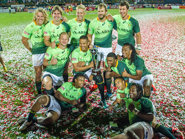 South African players bask in the moment  after South Africa beat Australia 33-7 in the Cup Final of the IRB Sevens World Series rugby tournament at the Emirates Airline Dubai Rugby Sevens in Dubai, UAE, on Saturday, Dec. 6th, 2014. Photo by: Stephen Hindley/Sportdxb/Photosport