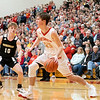 Westview Warriors guard Drew Litwiller (25) dribbles the ball against Churubusco Eagles guard Gage Kelly (10) during the Friday night game at Westview High School in Topeka.
