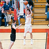 Westview Warriors guard Drew Litwiller (25) shoots a basket against Churubusco Eagles forward Hunter Perlich (3) during the Friday night game at Westview High School in Topeka.