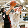 Wawasee Warriors guardKeaton Dukes (34) blocks a shot against NorthWood Panthers guard Cooper Wiens (20) during the NorthWood 3A Sectional Championship game Saturday evening at NorthWood High School.
