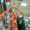 NorthWood Panthers guard Trent Edwards (10) cuts the net after winning the NorthWood 3A Sectional Championship game Saturday evening at NorthWood High School.