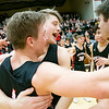 NorthWood Panthers forward Josh Stratford  (31), guard Brock Flickeringer (4), and guard Cooper Wiens (20) react after winning the NorthWood 3A Sectional Championship game Saturday evening at NorthWood High School.