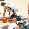 NorthWood Panthers guard Ben Vincent (5) battles for the ball against Wawasee Warriors guard Kameron Salazar (10) during the NorthWood 3A Sectional Championship game Saturday evening at NorthWood High School.