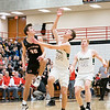 NorthWood Panthers guard Cooper Wiens (20) goes up for the ball against Wawasee Warriors guard Keaton Dukes (34) during the NorthWood 3A Sectional Championship game Saturday evening at NorthWood High School.