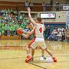 Northridge junior Carter Stoltzfus (12) tries to pass the ball around<br /> Warsaw senior Blake Marsh (4) during Saturday night's Elkhart Sectional<br /> championship game.