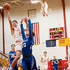 Westview Warriors senior Drew Litwiller (25) goes up for a lay-up against Bethany Christian Bruins senior Branden Bohn (20) during Tuesday's game at Westview Junior-Sr. High School in Topeka.