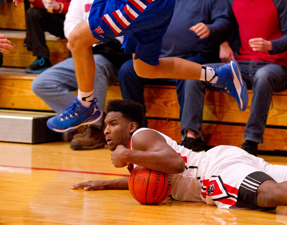 SAM HOUSEHOLDER | THE GOSHEN NEWS<br /> NorthWood junior Dakiyon Fox grabs a loose ball against West Noble Wednesday. NorthWood defeated West Noble 64-44.