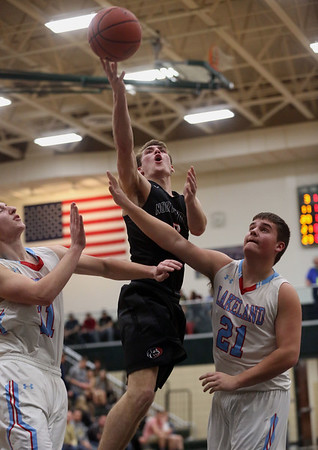 JAY YOUNG   THE GOSHEN NEWS<br /> NorthWood senior Vincent Miranda (5) gets a shot off over Lakeland defenders Jeffrey Patrick (21) and Colin Harp (11) during the quarterfinals of the 3A sectional Tuesday night at Wawasee High School in Syracuse.