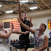 JAY YOUNG | THE GOSHEN NEWS<br /> NorthWood senior Vincent Miranda (5) gets a shot off over Lakeland defenders Jeffrey Patrick (21) and Colin Harp (11) during the quarterfinals of the 3A sectional Tuesday night at Wawasee High School in Syracuse.