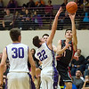 JAY YOUNG | THE GOSHEN NEWS<br /> Goshen High junior Will Line (11) slides past Elkhart Christian Academy senior Tyler Litwiller (22) to get off a shot as Jonah Jara Wallick (30) can only watch during their game Tuesday night in Elkhart.