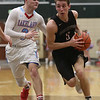JAY YOUNG | THE GOSHEN NEWS<br /> NorthWood senior Luke Vincent Miranda (5) drives past Lakeland senior Britain Isaacs (3) during the quarterfinals of the 3A sectional Tuesday night at Wawasee High School in Syracuse.