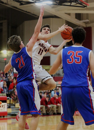 JAY YOUNG   THE GOSHEN NEWS<br /> Goshen High junior Will Line (11) slides past West Noble sophomore Nick Knepper (21) to get off a shot during their game Tuesday night at Goshen High School.
