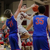 JAY YOUNG | THE GOSHEN NEWS<br /> Goshen High junior Will Line (11) slides past West Noble sophomore Nick Knepper (21) to get off a shot during their game Tuesday night at Goshen High School.