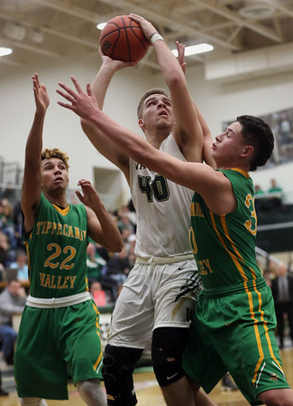 JAY YOUNG   THE GOSHEN NEWS<br /> Wawasee junior Trevon Coleman (40) muscles for position between Tippecanoe Valley defenders DeSean Heckman (22) and Alex Salas-Morrison (30) during the quarterfinals of the 3A sectional Tuesday night at Wawasee High School in Syracuse.