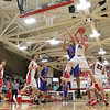 JAY YOUNG | THE GOSHEN NEWS<br /> Goshen High senior Mitchell Walters (24) rips a rebound away from West Noble senior Larry Nickolson (35) during their game on Tuesday night at Goshen High School.