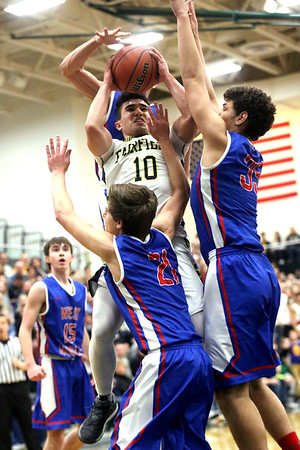 JAY YOUNG   THE GOSHEN NEWS<br /> Fairfield senior Brady Willard (10) takes on a triple team by West Noble defenders Nick Knepper (21), Larry Nickolson (35) and Trevor Franklin during their 3A sectional championship game on Saturday night.