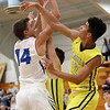 JAY YOUNG | THE GOSHEN NEWS<br /> Fairfield sophomore Cordell Hofer (12) goes for the block against Bethany junior Seth Brenneman (14) during their game Tuesday evening in Goshen.