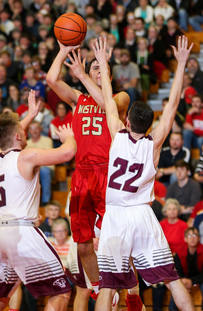 CHAD WEAVER | THE GOSHEN NEWS<br /> Westview's Cody Collyer puts up a shot over two Central Noble defenders during the first half of Friday night's 2A basketball sectional at Westview.
