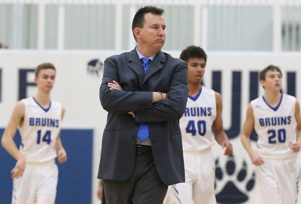 JAY YOUNG | THE GOSHEN NEWS<br /> Frustrated with his team's play, Bethany Christian coach Ryan Gingerich calls a time out during the Bruins' game against Triton on Friday evening at Bethany.