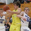 JAY YOUNG | THE GOSHEN NEWS<br /> Fairfield senior Jake Oberlin (14) holds off Bethany senior Joel Plank (24) as he grabs a rebound during their game Tuesday evening in Goshen.