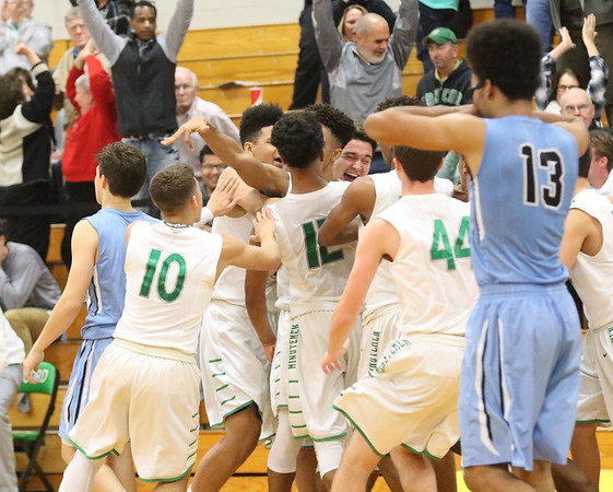 JAY YOUNG | THE GOSHEN NEWS<br /> Saint Joseph senior Muhammad Shabazz (13) can only watch as Concord players celebrate their last second victory following their game Tuesday evening in Dunlap.
