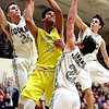JAY YOUNG | THE GOSHEN NEWS<br /> Fairfield sophomore Cordell Hofer (12) takes on Elkhart Christian Academy defenders Tyler Litwiller (22), Weston Sage (24) and Jakob Maxwell as he makes a drive to the basket during their game Tuesday night in Elkhart.