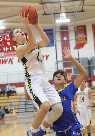 JAY YOUNG | THE GOSHEN NEWS<br /> Fairfield junior Luke Stephens hangs in the air as he sails past East Noble freshman Hayden Jones during their game in the 2016 Holiday Basketball Tournament hosted by Goshen High.