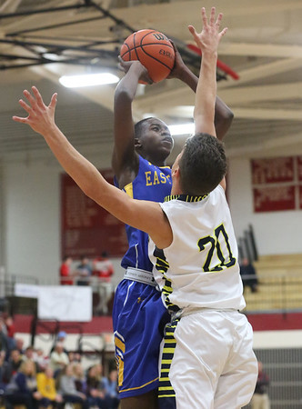 JAY YOUNG | THE GOSHEN NEWS<br /> East Noble sophomore Ali Ali looks to get a shot off over Fairfield defender Skylar Mast (20) during their game in the 2016 Holiday Basketball Tournament hosted by Goshen High.