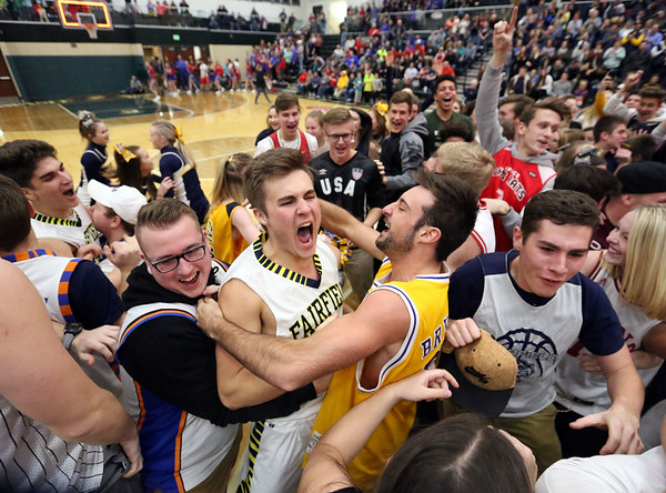 JAY YOUNG   THE GOSHEN NEWS<br /> Fairfield senior Zach Munn celebrates with students following their 3A sectional championship victory over West Noble on Saturday night in Syracuse.