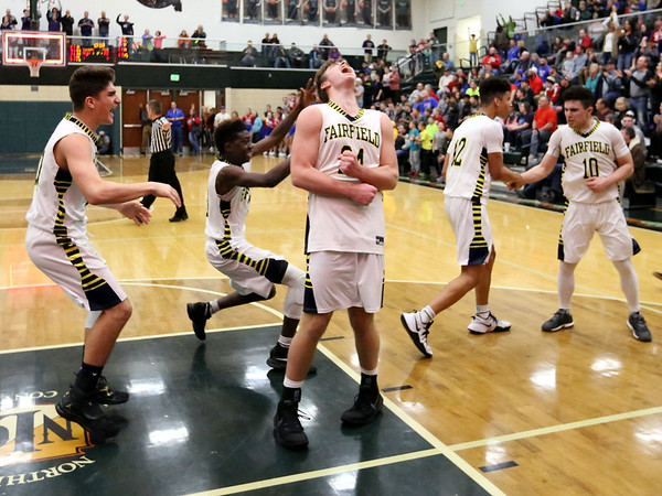 JAY YOUNG   THE GOSHEN NEWS<br /> Fairfield junior Shandon Miller lets out a scream while teammates celebrate behind him following their 3A sectional championship victory over West Noble on Saturday night in Syracuse.
