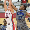 JAY YOUNG | THE GOSHEN NEWS<br /> Goshen's Mitchell Walters (24) pulls a rebound away from Marian's Michael Hemingway (10) during their game on Tuesday evening at GHS.