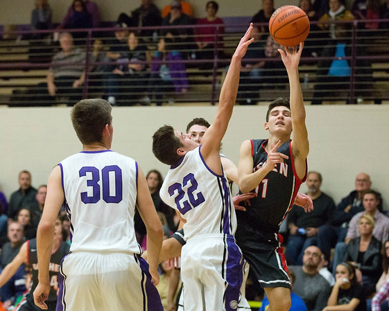 JAY YOUNG   THE GOSHEN NEWS<br /> Goshen High junior Will Line (11) slides past Elkhart Christian Academy senior Tyler Litwiller (22) to get off a shot as Jonah Jara Wallick (30) can only watch during their game Tuesday night in Elkhart.