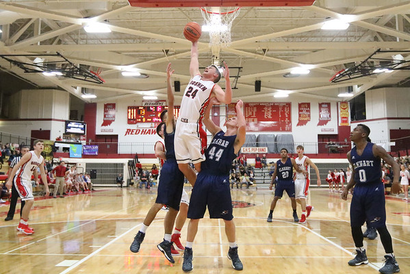 JAY YOUNG   THE GOSHEN NEWS<br /> Goshen High senior Mitchell Walters (24) skies for a rebound over Elkhart Central's Andrew Salmon (44) and Jacob Kaiser during their game in the 2016 Holiday Basketball Tournament hosted by Goshen High.