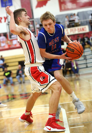 JAY YOUNG   THE GOSHEN NEWS<br /> West Noble sophomore Takota Weigold (11) pushes into Goshen High senior Eliot Nafziger to create space during their game Tuesday night at Goshen High School.