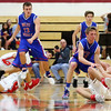 JAY YOUNG | THE GOSHEN NEWS<br /> Goshen High senior Eliot Nafziger  (34) dives to the floor to pick up a loose ball in front of West Noble sophomore Trevor Franklin (23) during their game Tuesday night at Goshen High School.