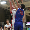 JAY YOUNG | THE GOSHEN NEWS<br /> West Noble senior Larry Nickolson (35) gets his hand on a shot by Goshen High senior Mitchell Walters during their game Tuesday night at Goshen High School.