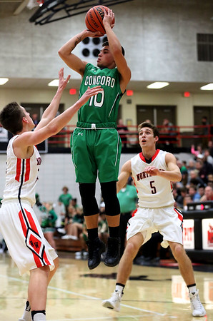 JAY YOUNG | THE GOSHEN NEWS<br /> Concord senior Brandon Emerick (10) elevates for a jumper between NorthWood defenders Vincent Miranda (5) and Caleb Glick during their game Thursday night in Nappanee.