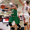 JAY YOUNG | THE GOSHEN NEWS<br /> Concord senior Brandon Emerick (10) slips past NorthWood junior Caleb Lung (22) as he finds a path to the basket during their game Thursday night in Nappanee.