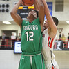 JAY YOUNG | THE GOSHEN NEWS<br /> Concord senior Cedric Mitchell (12) muscles a shot up over NorthWood junior Caleb Lung during their game Thursday night in Nappanee.