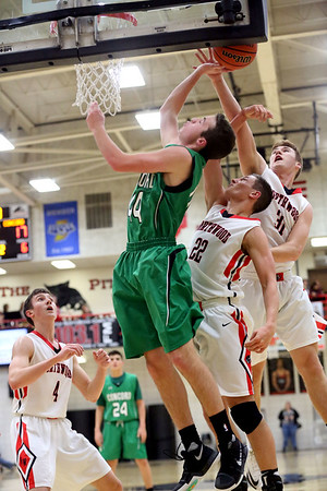 JAY YOUNG   THE GOSHEN NEWS<br /> NorthWood senior Trey Bilinski (31) gets the block as he and teammate Caleb Lung (22) defend a shot by Concord junior Matt Auger (44) during their game Thursday night in Nappanee.