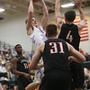 JAY YOUNG | THE GOSHEN NEWS<br /> Lakeland senior Christian Roose (30) puts up a shot in front of NorthWood defenders Luke Zurcher (4) and Trey Bilinski (31) during the quarterfinals of the 3A sectional Tuesday night at Wawasee High School in Syracuse.