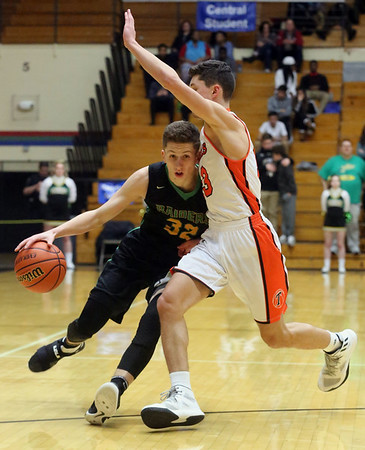 JAY YOUNG   THE GOSHEN NEWS<br /> Northridge senior Luke Morrison (32) leans into Warsaw junior Jack Rhoades (13) as he tries to drive past Rhoades during their 4A sectional tournament game Wednesday night at Northside Gym in Elkhart.