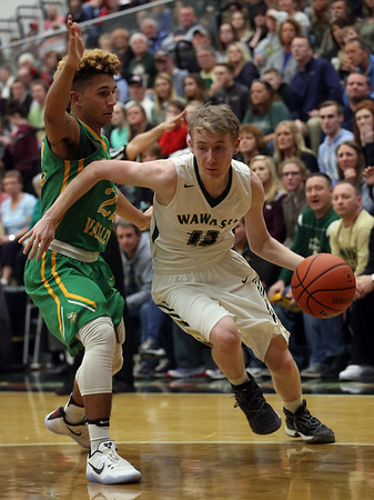 JAY YOUNG | THE GOSHEN NEWS<br /> Wawasee senior Cameron Schlabach (12) uses his off arm to create space as he dives baseline past Tippecanoe Valley senior DeSean Heckman (22) during the quarterfinals of the 3A sectional Tuesday night at Wawasee High School in Syracuse.