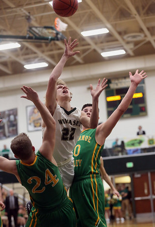 JAY YOUNG   THE GOSHEN NEWS<br /> Wawasee junior Jacob Hand (22) spits Tippecanoe Valley defenders Alec Craig (24) and Alex Salas-Morrison (30) as he gets off a shot during the quarterfinals of the 3A sectional Tuesday night at Wawasee High School in Syracuse.