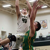 JAY YOUNG | THE GOSHEN NEWS<br /> Wawasee junior Trevon Coleman (40) elevates for a shot over Tippecanoe Valley sophomore Alex Salas-Morrison (30) during the quarterfinals of the 3A sectional Tuesday night at Wawasee High School in Syracuse.